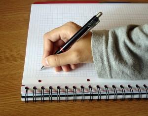 hand-writing-on-pad-50-300x235
