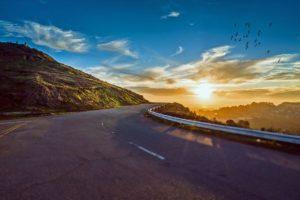 mountain-road-sunset birds curve